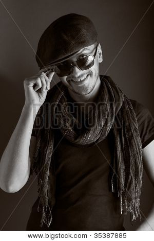 handsome young guy posing with hat