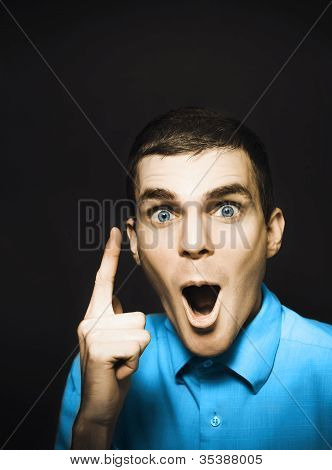 Happy Young Man Pointing At Blank Copyspace