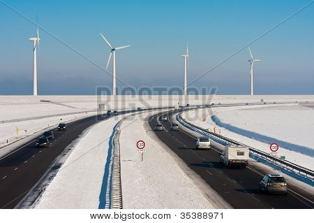 Dutch Rural Winter Landscape With A Highway And Big Windturbines