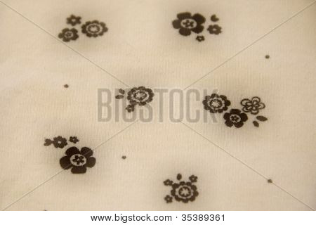white and black floral vintage fabric