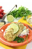 picture of hake  - Hake with lemon slice parsley and potato salad on a light background - JPG