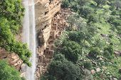 stock photo of dogon  - Old Dogon buildings and waterfall in Dogonland - JPG