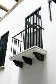 pic of hacienda  - Colonial balcony from a vintage mexican building hacienda style - JPG