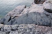 stock photo of feldspar  - An intrusive black dike on shore Superior Lake - JPG
