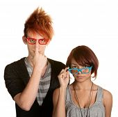 stock photo of dork  - Awkward male and female teenager adjusting their glasses - JPG