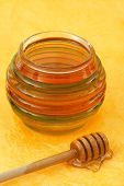 Jar Of Honey With Wood Stick poster