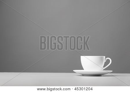 White mug on a gray background.