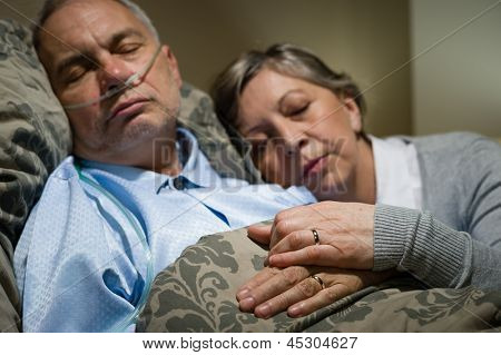 Old couple sleeping together in bed man with nasal cannula