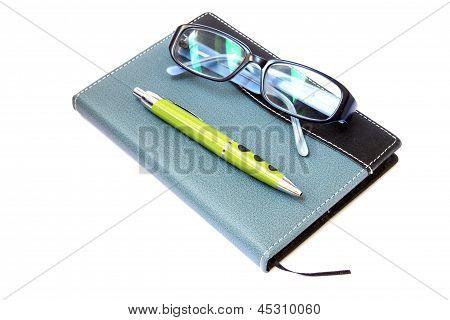 Glasses  Pen On  Notebook