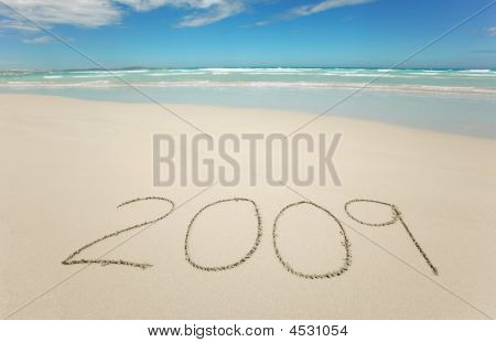 Year 2009 Written On Tropical Beach