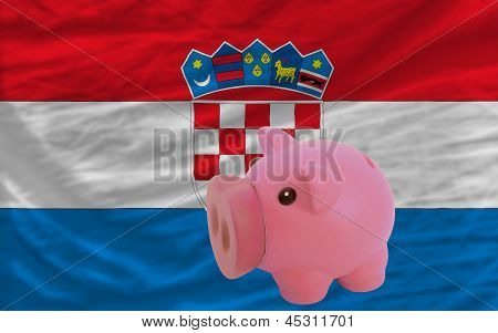 Piggy Rich Bank And  National Flag Of Croatia