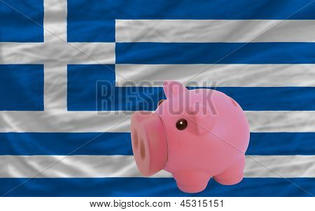 Piggy Rich Bank And  National Flag Of Greece