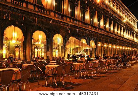 VENICE, ITALY - APRIL 12: Caffe Florian in Piazza San Marco at night on April 12, 2013 in Venice, Italy. Caffe Florian, established in 1720, is the oldest coffee house in continuous operation