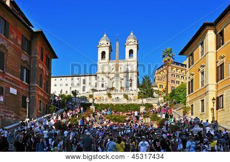ROME, ITALY - APRIL 18: A crowd in Piazza di Spagna, the Spanish Steps, the stairway of Trinita dei Montei, on April 18, 2013 in Rome, Italy. Piazza di Spagna is one of the most famous place in Rome