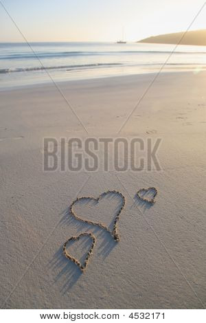 Three Love Hearts On A Pristine Beach
