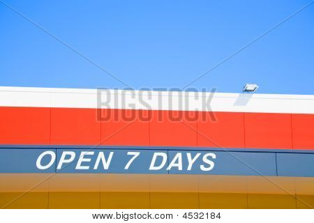 Open 7 Days Sign Painted Above A Shop