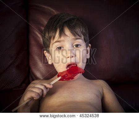 Boy Eating A Lollipop