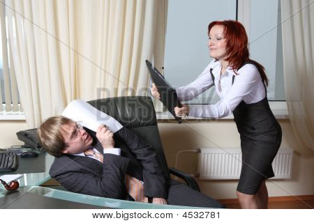 Furious Secretary Beats Boss