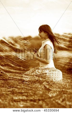 retro sepia photo girl beautiful brunette lying in field flowers