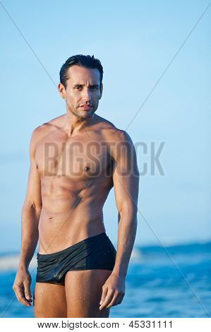 Portrait of a man standing on the beach