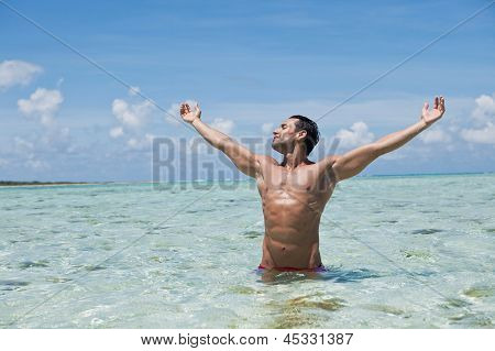 Man enjoying in water on the beach