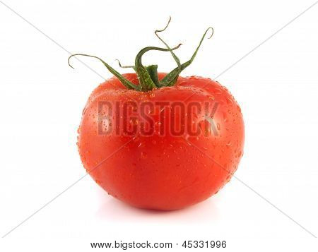Fresh red tomato. Isolated on a white background.