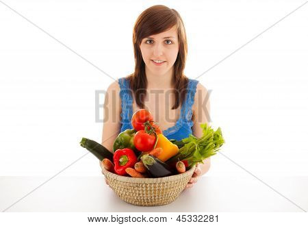 A Young Woman With A Basket Full Of Vegetables