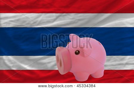 Piggy Rich Bank And  National Flag Of Thailand