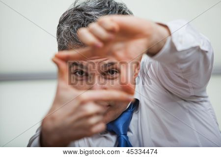 Businessman making a finger frame