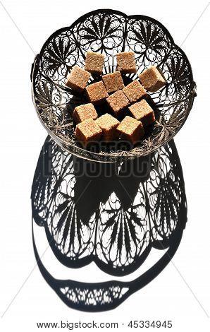 Pieces Of Brown Sugar In Vintage Bowl