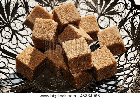 Pieces Of Brown Sugar In Vintage Bowl
