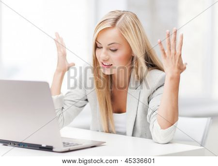 picture of angry businesswoman with laptop at work