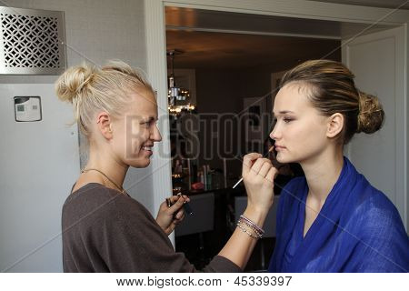 NEW YORK - APRIL 21: A Model gets ready backstage for Anne Barge bridalshow