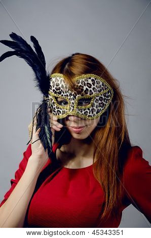 Beautiful Young Girl In A Red Dress And Mask
