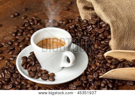 coffee cup with burlap sack and coffee beans