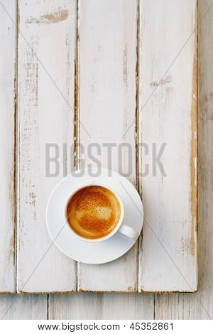 espresso coffee in white cup on old rustic  style table, shallow dof