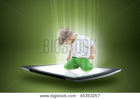 Little Boy On A Tablet With Beams Of Data