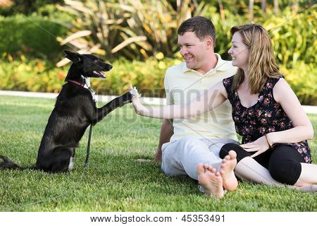 Happy young couple and their dog