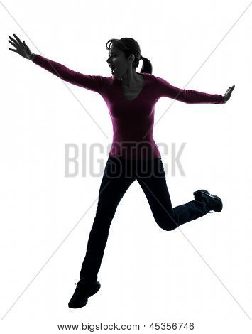 one caucasian woman happy running jumping   in silhouette studio isolated on white background