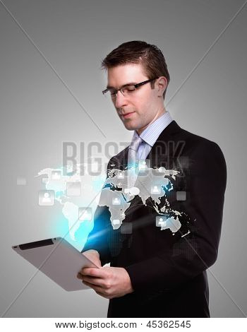 Business man using a touch screen device with social network
