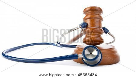 Medicine law concept gavel and stethoscope isolated on white background