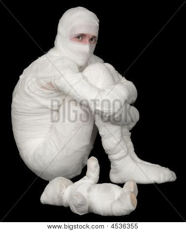 Egyptian Mummy Emo Sitting On A Black