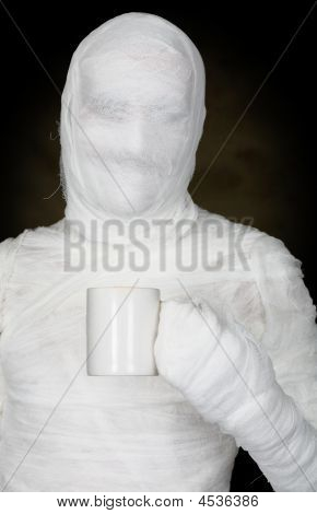 Man In Bandage With Mug