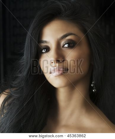 Beautiful young female with exotic eyes and straight long back hair
