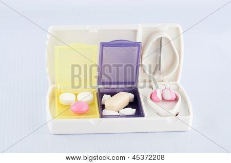 Pill Box And Split Blade Tablet Show Medicine Concept