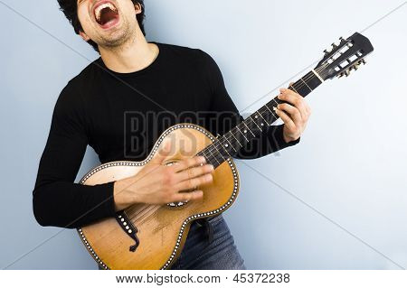 Happy Man Playing Acoustic Guitar