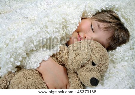 Girl With A White Blanket And A Soft Toy Dog