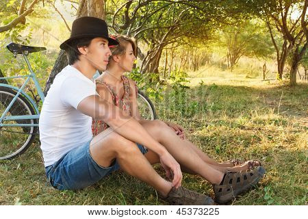 Young Woman And Man With Retro Bicycle In A Park