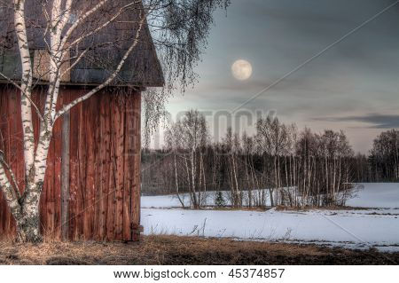 Old Red Barn In A Countryside Landscape