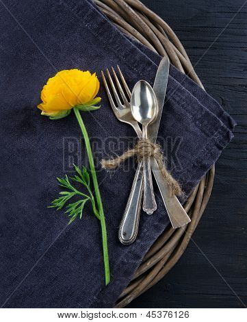 Rustic Dinner Setting With With A Yellow Flower